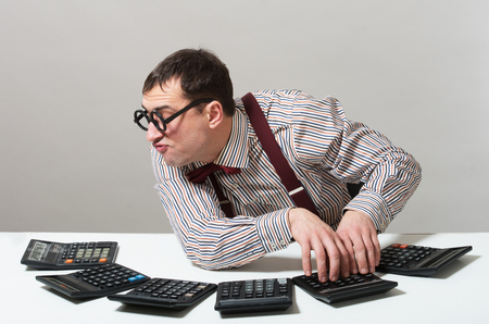 Humorous portrait of a crazy accountant photo
