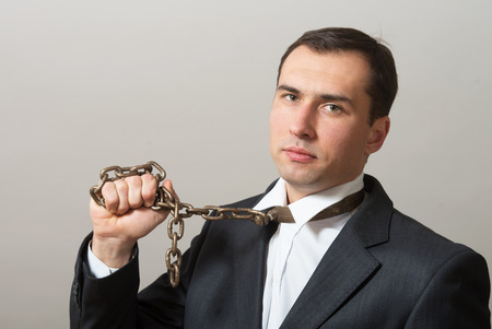 enchain: Businessman with neck chain looking at camera