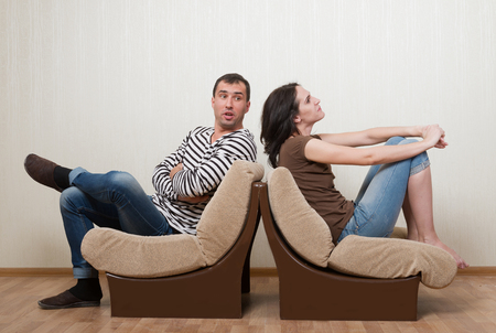turn away: Couple quarreling with each other
