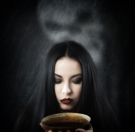 daunting: Witch with a cup of potion