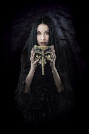 daunting: Witch holding a mask