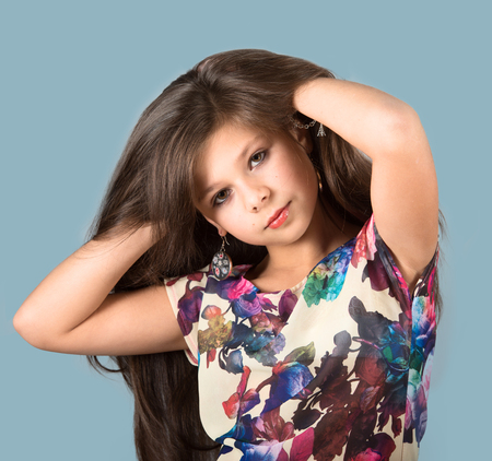 youngsters: Portrait of a fashionable preteen girl, studio shot, gray background Stock Photo