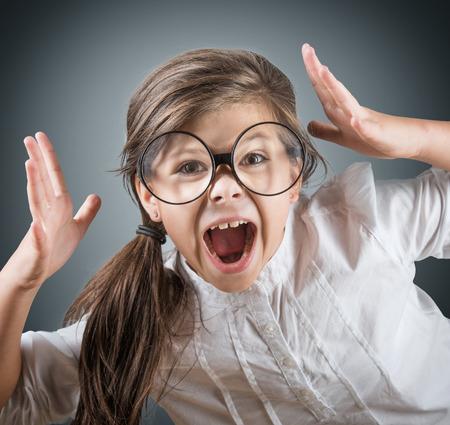 screaming girl: Funny screaming girl, studio shot