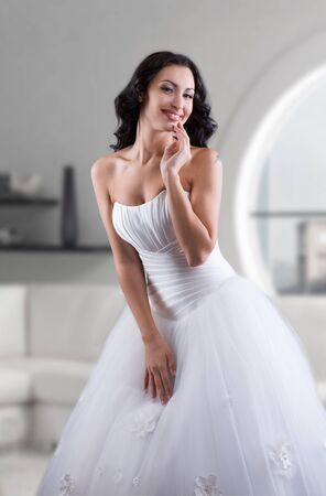 bride dress: Smiling beautiful bride posing for photo, indoors portrait