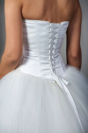 bridal gown: Closeup shot of a bridal gown with corset, back view