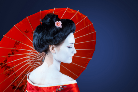 woman face profile: Portrait of a woman in red kimono with umbrella, view from back