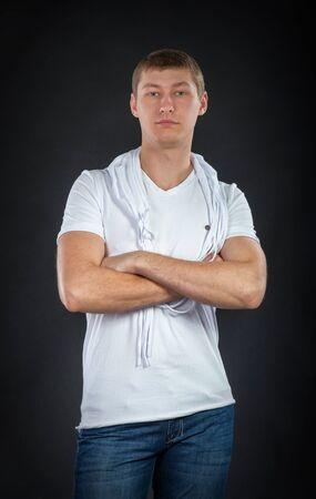 slavonic: Portrait of young slavonic man, dark background Stock Photo
