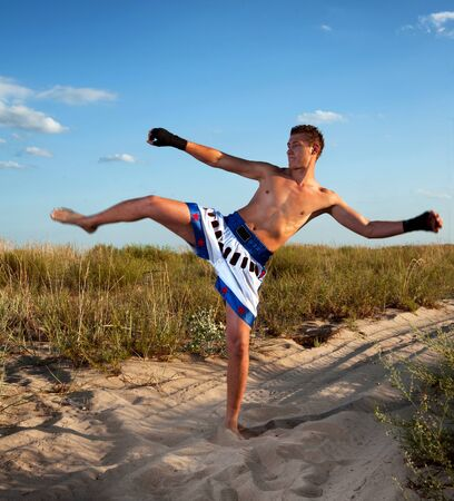 boxer shorts: Thai boxer outdoors portrait