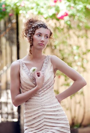 spangled: Young woman in spangled dress with a little white rose