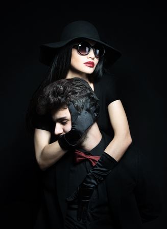 black satin: Portrait of an attractive young couple