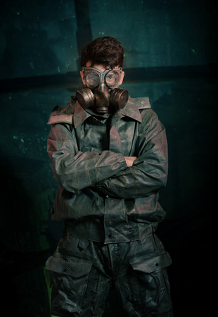 devastating: yberpunk stalker soldier in chemical protection armor and googles Stock Photo