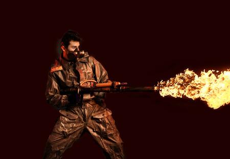 Soldier with flamethrower, dark background
