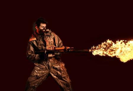 devastating: Soldier with flamethrower, dark background