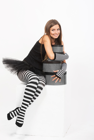 stockings woman: Smiling girl in black and white striped tights with the gift boxes