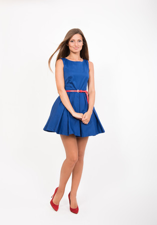 smiling girl: Smiling pretty girl in blue dress, studio full length portrait