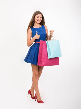 shoes woman: Smiling girl with the shopping bags showing the thumbs up