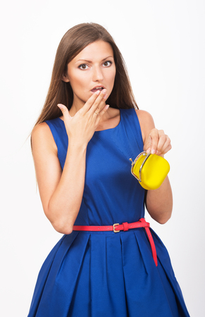 spendthrift: Studio portrait of an uneconomical girl with the empty purse