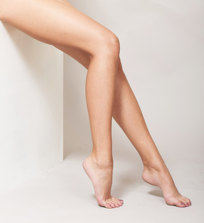 naked woman sitting: Female legs