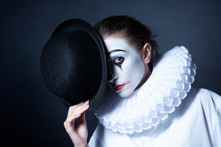 pierrot: Sad mime Pierrot holding a black hat