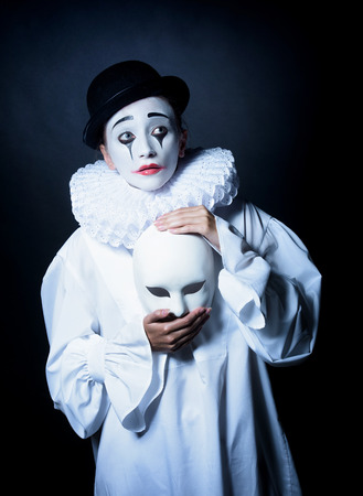 pierrot: Sad mime Pierrot with a mask