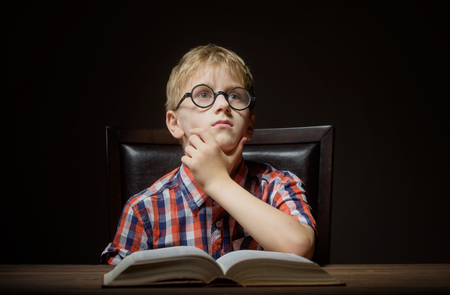 preteen boys: Boy dreaming with a book
