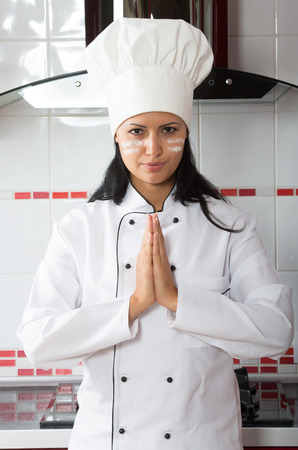 culinary skills: Humorous portrait of a woman in the kitchen before cooking