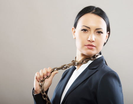 Female office worker with chain tie, concept Stock Photo