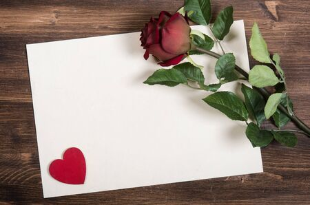 red paper: Decorative heart and red rose on the blank paper Stock Photo