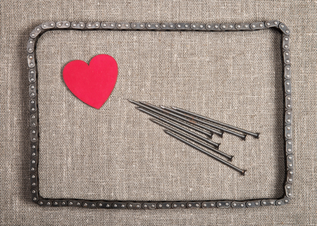 Decorative heart and the nails in bicycle chain frame
