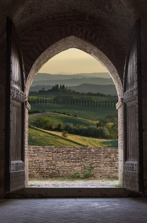 Tuscan view through the arch entrance Stock Photo - 46644874
