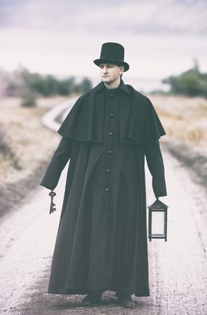 sullen: Stylized portrait of a sullen man in garrick coat with a lantern ant a bundle of keys in his hands