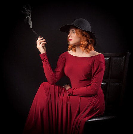 unwholesome: Smoking woman in red dress