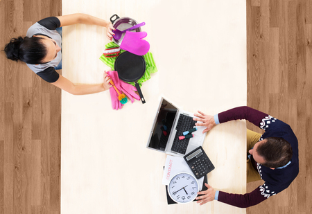 business roles: Man and woman exchanging their social roles Stock Photo