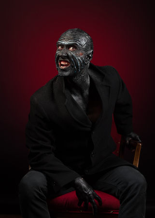 bared teeth: Man in monster makeup Stock Photo