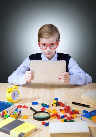 children learning: Boy using a digital tablet