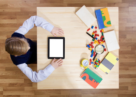 alone boy: Boy using a digital tablet, view from above Stock Photo