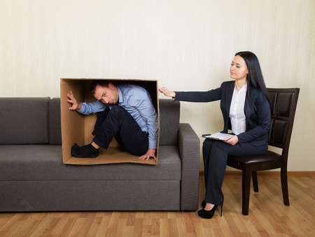 withdrawn: Psychotherapy - humorous concept photo Stock Photo