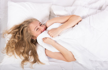 lighthearted: Well-rested girl waking up