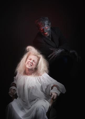 bedlam: Nightmare. Insane woman and her inner monster, dark background Stock Photo