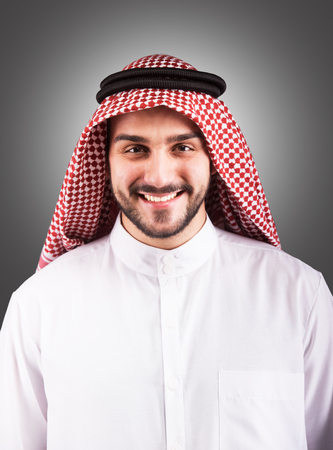 Studio portrait of a smiling handsome arabian man