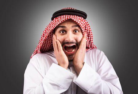 thobe: Studio portrait of a shocked arabian man