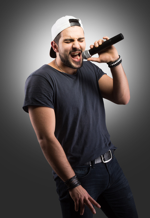 rapping: Young man singing into a microphone