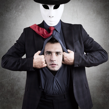 dissimulation: Man in mask showing his true face, concept Stock Photo