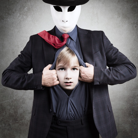 Man in mask showing his Inner child, psychological concept Stock Photo