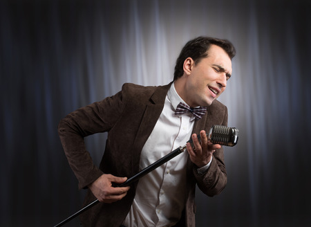 the showman: Showman with a microphone Stock Photo