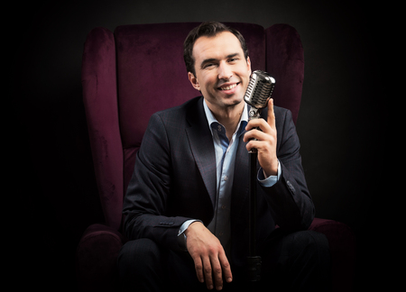 announcer: Radio presenter with a microphone Stock Photo