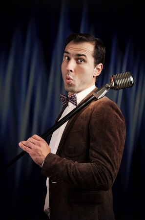 Showman with a microphone Stock Photo