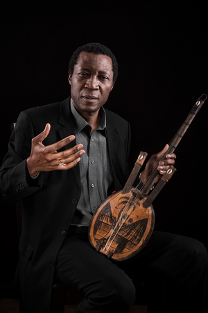 African black man with ethnic musical instrument