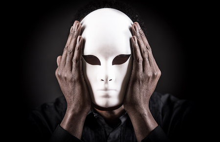 Dramatic art portrait of african black man with white mask. Stock fotó