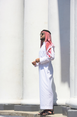 thobe: Full-length portrait of a handsome arabian man
